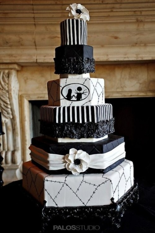 a black and white Halloween wedding cake with geometric tiers, various patterns and Corpse Bride and her groom silhouettes