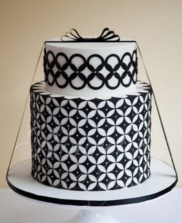 a bold black and white wedding cake with a geometric print and some black ribbon for a bold modern wedding