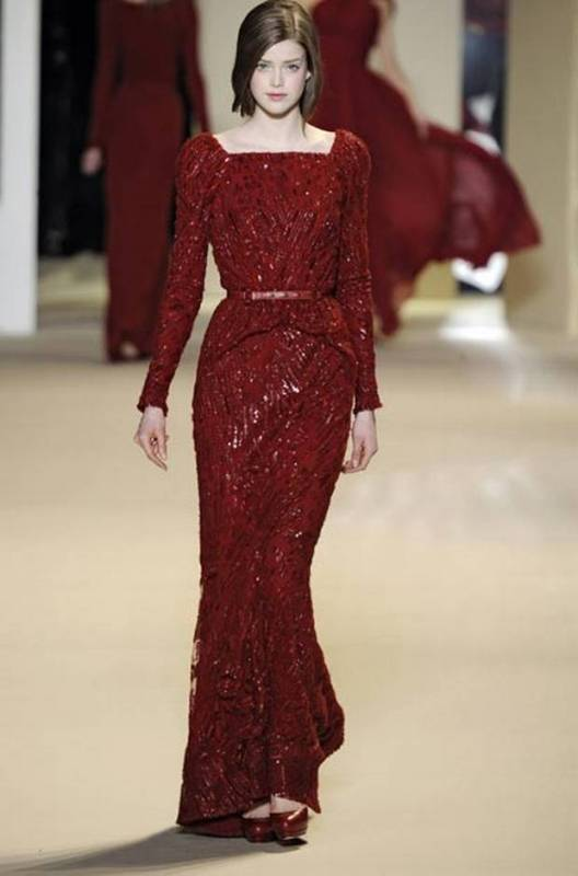 a fully embellished deep red wedding dress with a belt and long sleeves is a cool and really unique idea