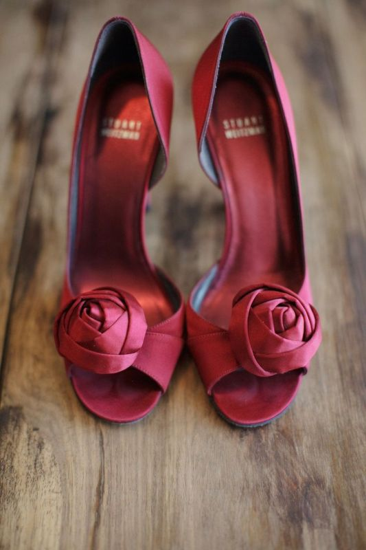 deep red fabric bloom wedding for a touch of color won't overdo with reds yet will add a splash of color