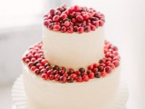 a buttercream wedding cake topped with cranberries is a cool and delicious idea with a fresh touch