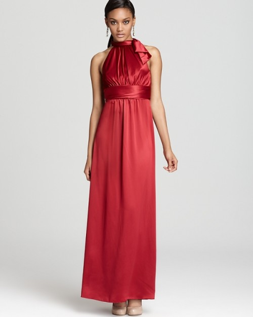 a deep red halter neckline maxi bridesmaid dress is a cool and bold idea to go for at a fall wedding