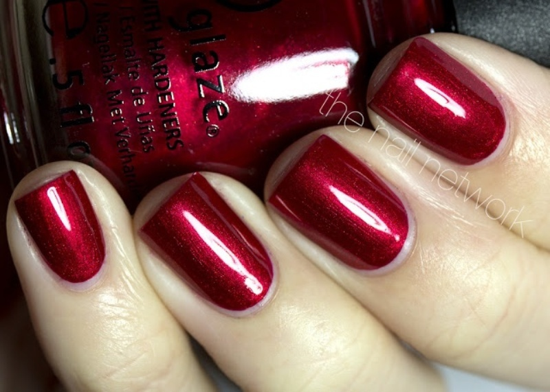 a shiny deep red manicure is a cool idea for a fall bride, it will add color to your look
