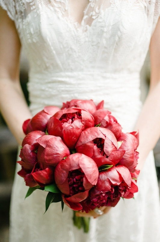a deep red peony wedding bouquet is a statement idea for a fall or winter wedding