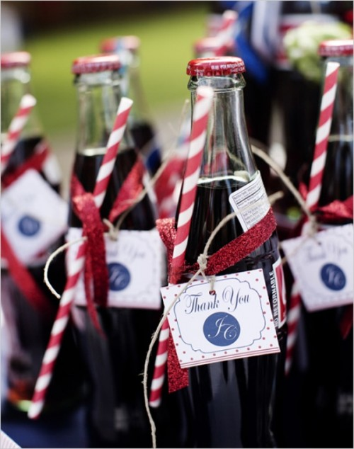 Coke bottles with tags and striped straws are amazing for having a drink at the wedding