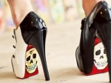 black and white high heels with red bottoms and skulls on them are a fantastic idea to make a bold statement at a Halloween wedding