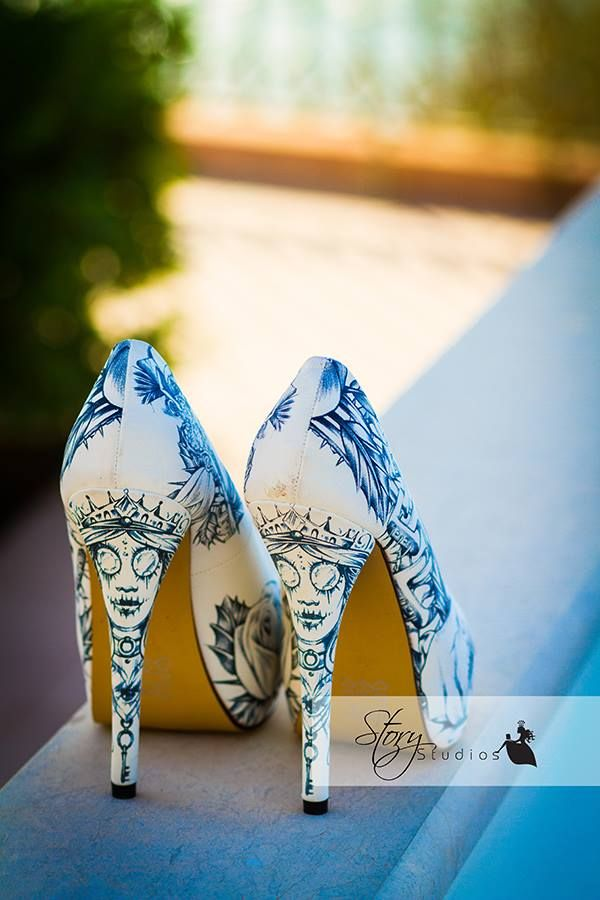 white shoes with blue Corpse Bride painted on them are a unique idea for fans of Tim Burton or for a Tim Burton's inspired wedding