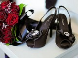 black peep toe slingbacks with black bows and skulls pinned to the front are a chic and bold idea for a Halloween or Gothic bride