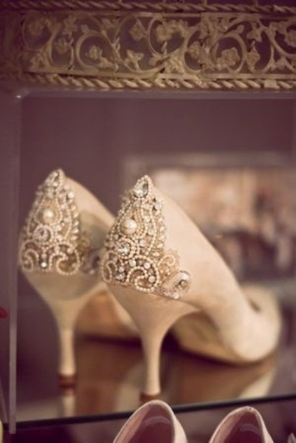 tan suede wedding shoes with heavily embellished backs with beads, crystals and various patterns