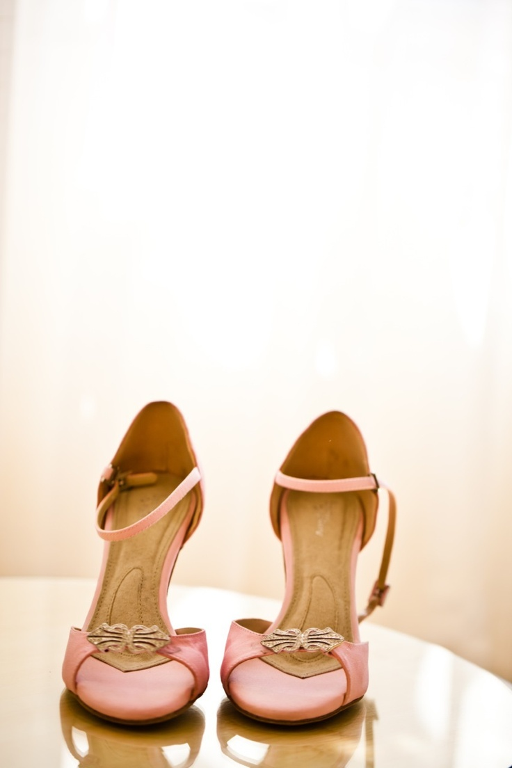 pink shoes with open toes and embellishments plus ankle straps add vintage chic and romance to the look