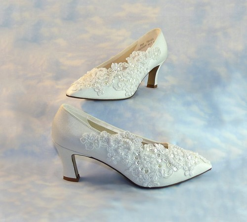 white vintage wedding shoes with lace and embellishments that make it refined and chic