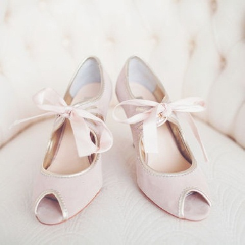 light pink peep toe shoes with blush bows add a slight touch of color and bring a romantic feel to the look