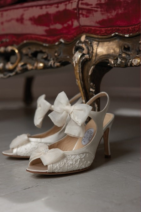 white lace and plain leather cutout shoes with peep toes, ribbon bows add romance to the bridal look