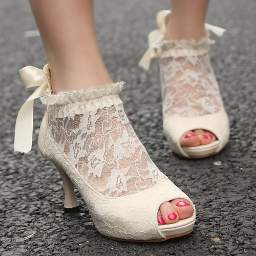 ivory peep toe wedding booties of lace, with a ribbon bow on the back are very chic and romantic