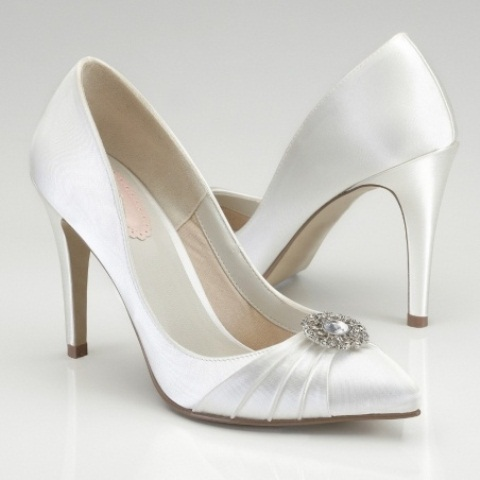 white vintage satin wedding shoes with embellishments and pointed toes are an elegant solution for a vintage bride
