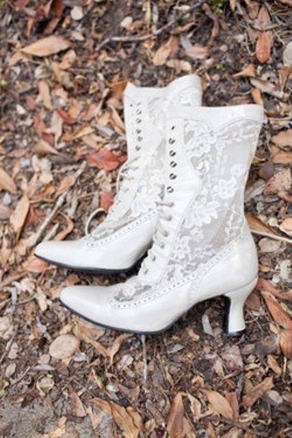 white vintage wedding boots of lace and white leather and lacing up add a cool vintage touch to the look