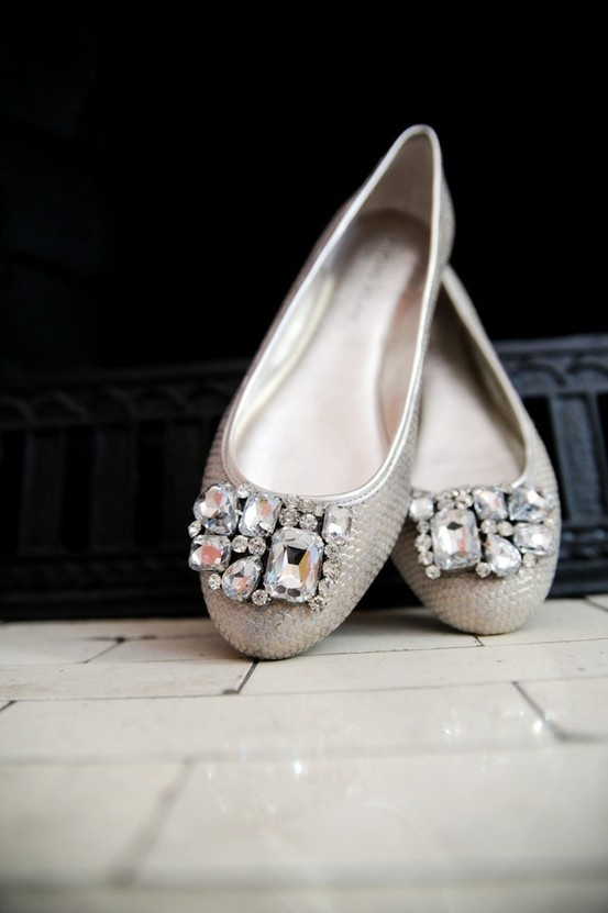 fully embellished silver flats with large statement embellishments on top look shiny and bold