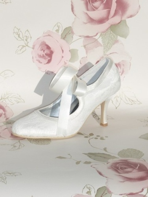 white vintage cutout wedding shoes with ribbon bows look romantic and sophisticated