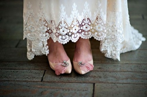 vintage tan wedding shoes with embellishments and pink feathers add a refined and romantic touch to the look