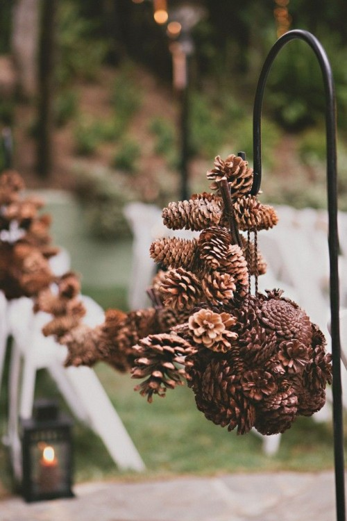 a pinecone ball and a garland will bring a cool woodland feel to your wedding ceremony space and make it cool