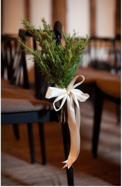 evergreens with white ribbon bows will highlight your wedding chairs and refresh the look of the ceremony space