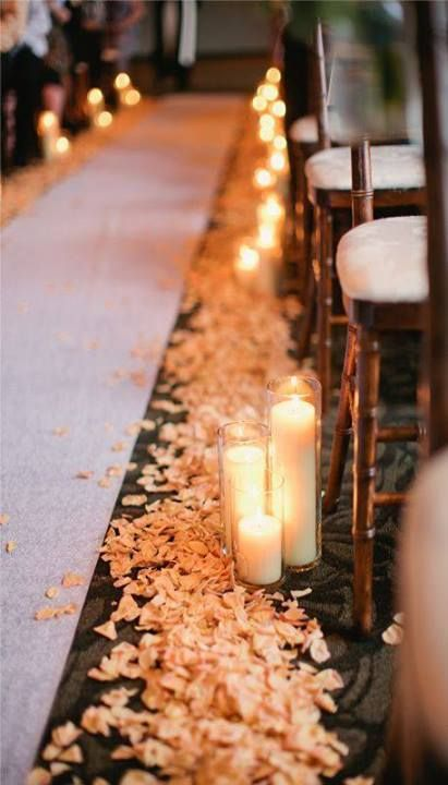 bright petals and pillar candles are a popular way to accent the wedding aisle, not only fora winter but also for any other wedding