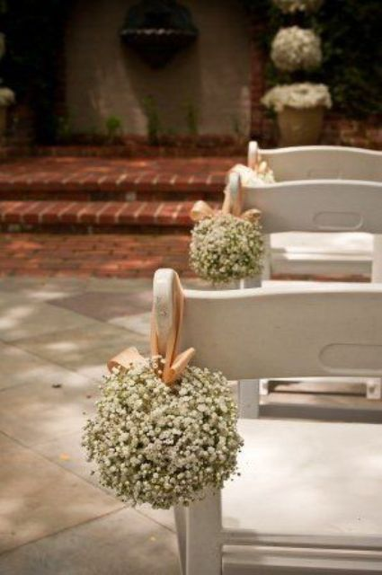 baby's breath balls with ribbons are a nice way to accent the aisle and they will bring timeless elegance