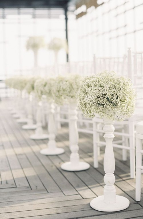 baby's breath topiaries on stands are traditional and elegant decorations for wedding aisles