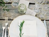 place some greenery on each place setting to refresh the tablescape in a subtle way