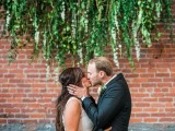 greenery decor on the wall makes up a cool wedding backdrop or just a backdrop for your wedding portraits