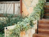 decorate the railing with lush greenery to make the wedding decor fresh and cool