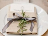 add rosemary branches to place settings to make your wedding decor fresher and cooler