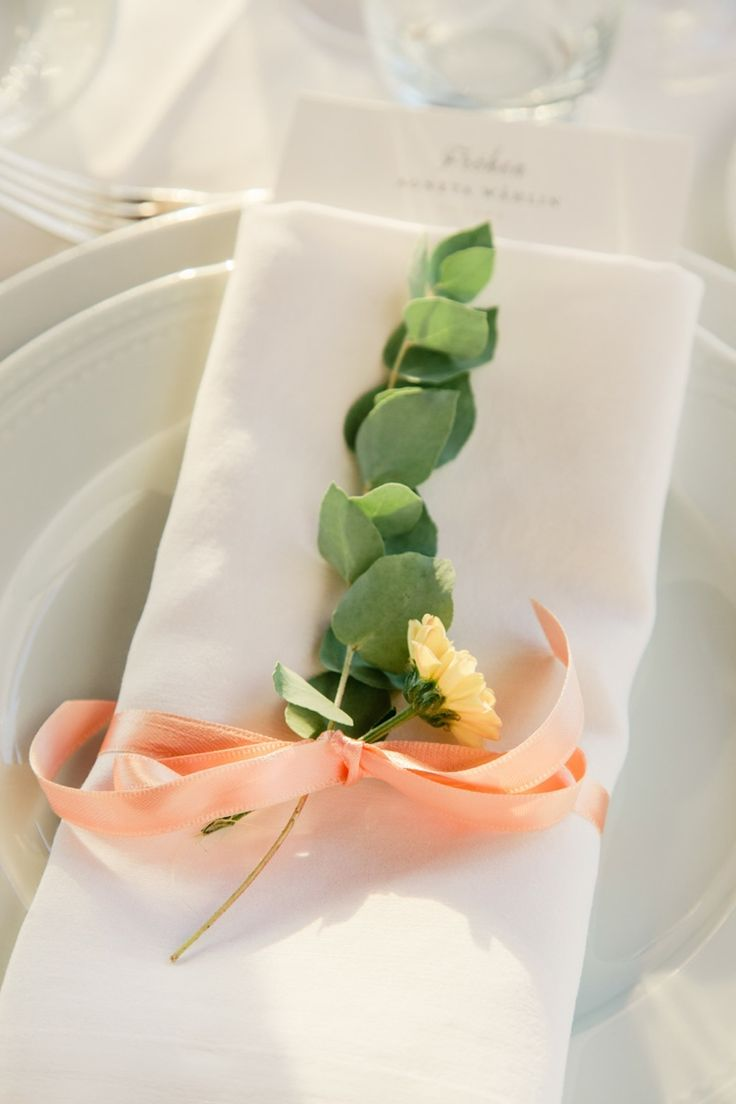 eucalyptus, a single bloom and a peachy bow will spruce up your place setting in a chic and bold way