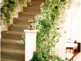 lush greenery and white blooms covering the railings make the space feel fresh and bold and more outdoorsy