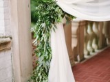 airy white curtains with greenery that holds them is a very cool and fresh decor idea that won't cost a lot