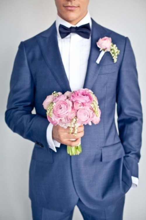 a navy suit, a white shirt, a midnight blue bow tie plus a romantic pink boutonniere