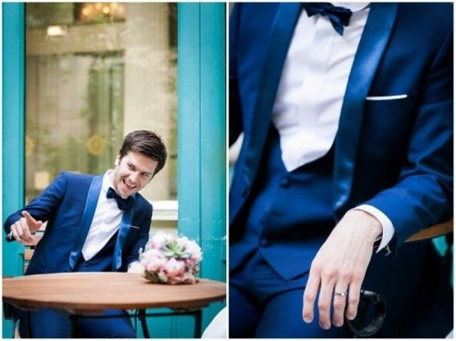 a navy three-piece wedding suit with silk lapels, a waistcoat, a white shirt and a black bow tie