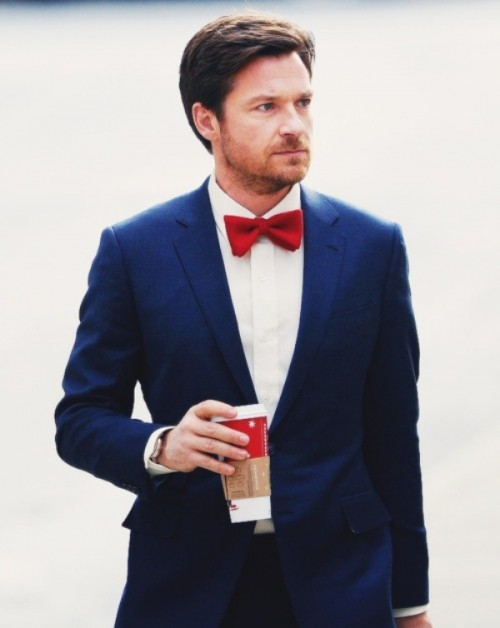 a navy suit, a white shirt and a bold red bow tie will make your look contrasting, bold and catchy