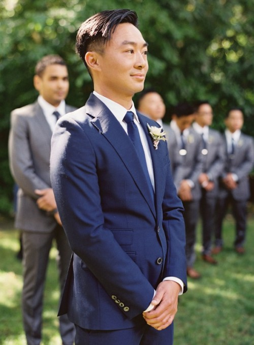 a navy suit, a white shirt and a navy tie to create a stylish and elegant groom's look