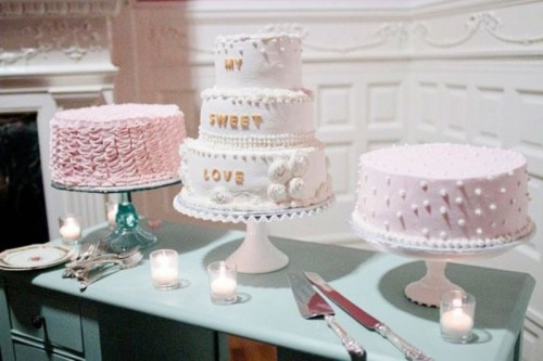 simple sheer, pink and white cake stands and an assortment of pink and white wedding cakes
