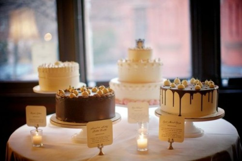 white wooden cake stands with an assortment of fun modern wedding cakes are a chic idea