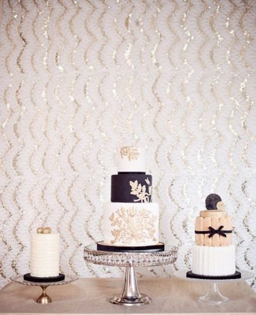 sheer stands don't distract attention from white, black and blush wedding cakes with blooms and bows