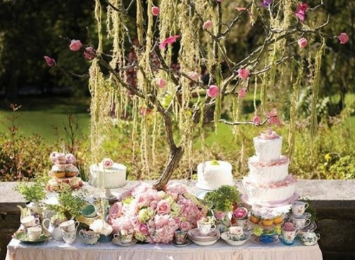 simple stands for wedding cakes and lots of blooms and vintage teacups to make the sweet table look vintage and sweet