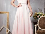 a blush A-line one shoulder wedding dress with an embellished cap sleeve and a pleated skirt