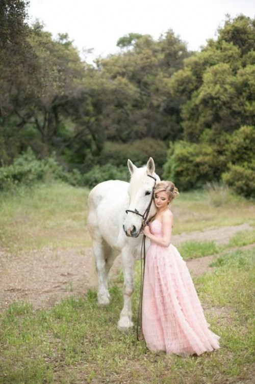 a strapless blush wedding dress with a draped bodice, a ruffle skirt is veyr romantic and feels princess-like
