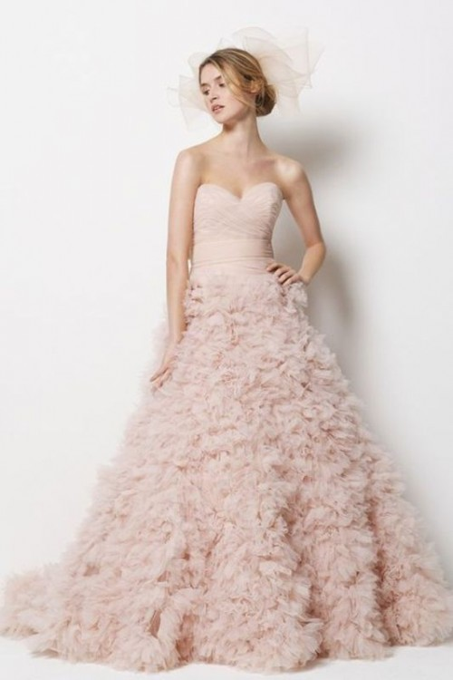 a princess-style blush strapless A-line wedding dress with a pretty ruffle skirt is sure to make a statement