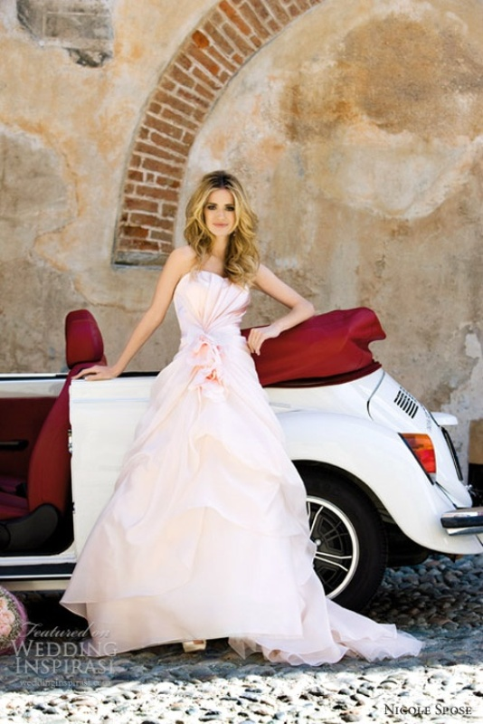 a strapless blush wedding dress with a draped bodice and skirt is a whimsy take on a classic wedding ballgown