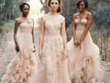 a strapless blush wedding dress with a layered skirt, an illusion neckline blush wedding dress with appliques and an A-line blush wedding dress with floral appliques