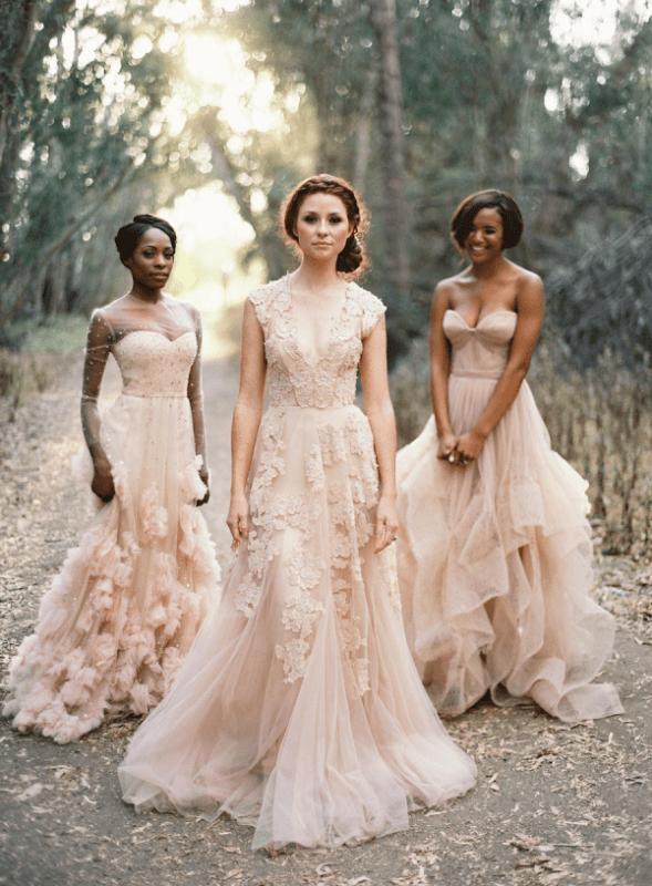 a strapless blush wedding dress with a layered skirt, an illusion neckline blush wedding dress with appliques and an A line blush wedding dress with floral appliques