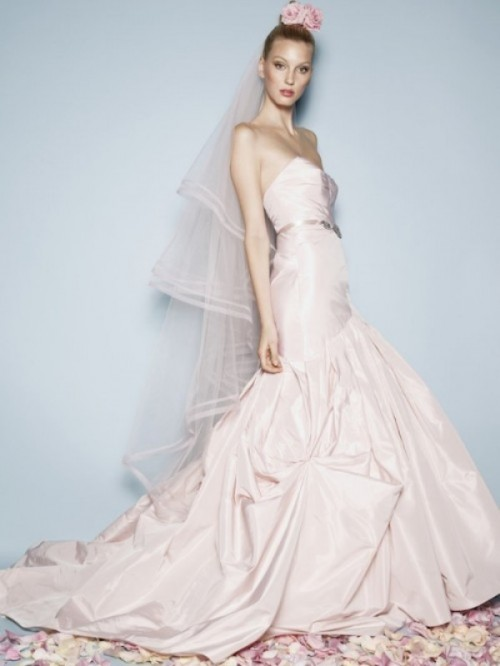 a strapless blush mermaid wedding dress with a draped bodice and skirt plus a long train